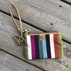 Coach multi colored striped wristlet